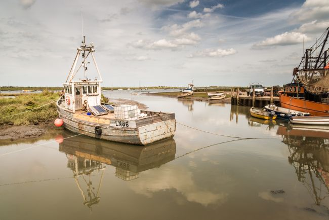 Stephen Mole | Fishing Boat moored at Brancaster Staithe
