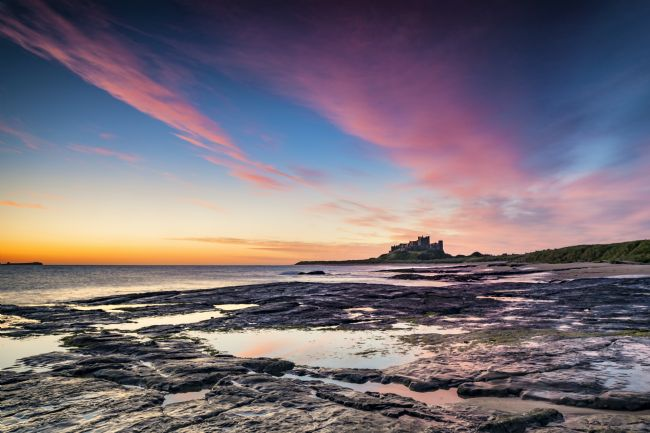 Richard Burdon |  Sunrise Over Bamburgh Castle
