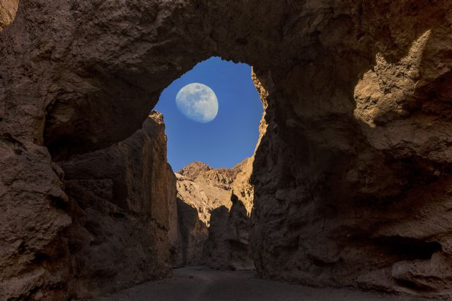 Reg Atkinson | Moon Through Rock Arch