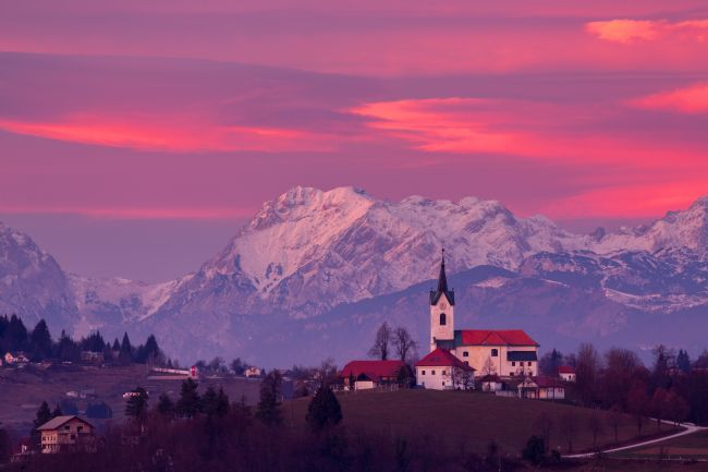 Ian Middleton | Prezganje church with snowy Kamnik Alps at sunset