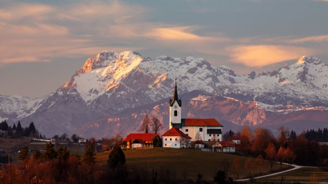 Ian Middleton | Prezganje church with snowy Kamnik Alps in the background.
