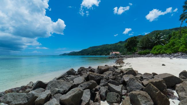 Mark Stinchon | Seychelles Beach Landscape Photo with Rocks