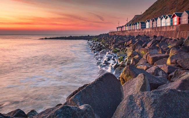David Powley | Sheringham beach huts at dawn
