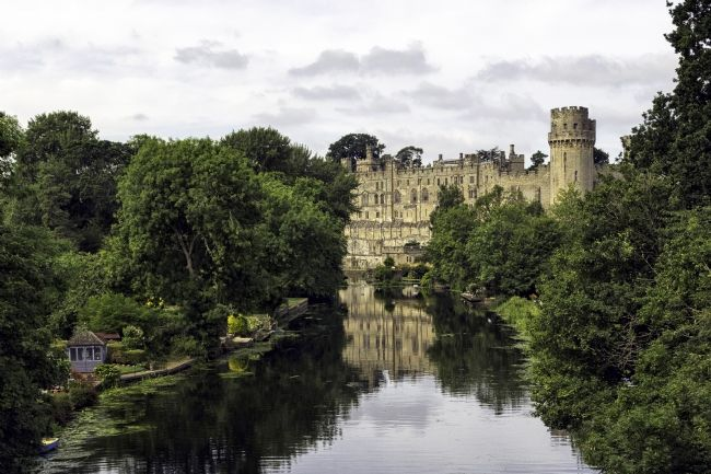 Jon  Jones | Warwick Castle in Warwickshire from the River Avon